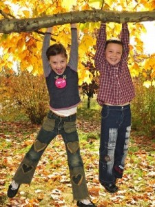 bigstock-kids-hanging-from-branch-of-tr-26344226