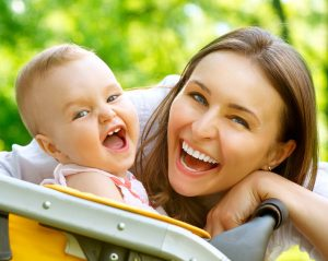 Laughing-Mother-And-Baby-outdoors